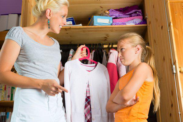 mother picking clothes for daughter