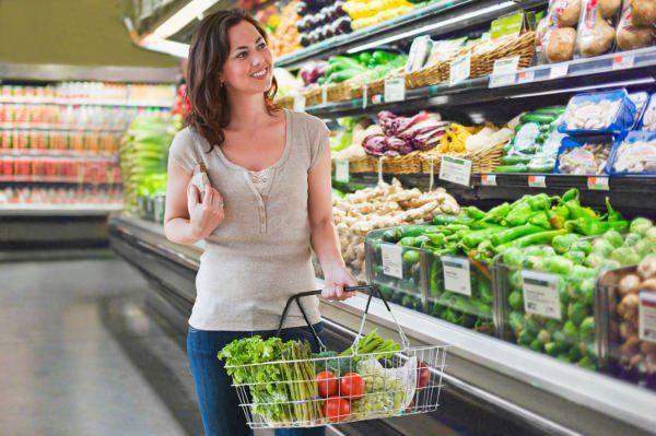 happy woman doing grocery shopping