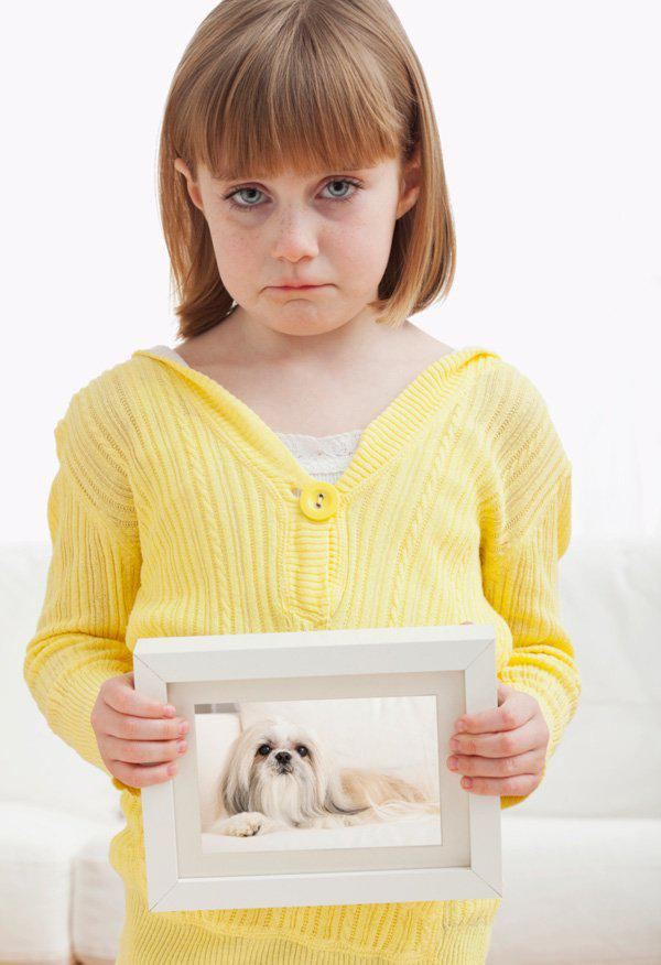 sad girl with picture of a dog