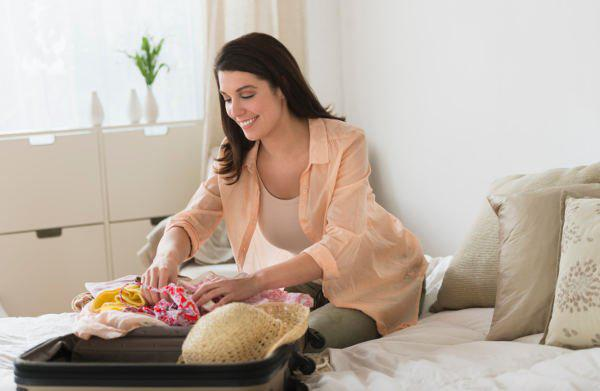 woman unpacking suitcase