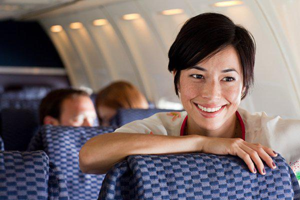 young woman on a plane