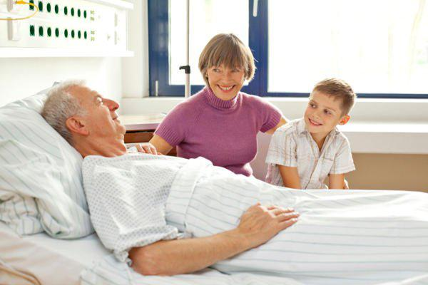 Grandmother and grandson with grandfather at hospital