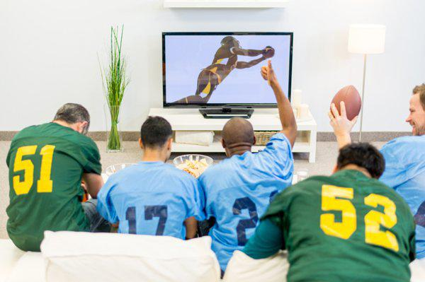 friends watching superbowl at home