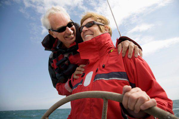 mature couple sailing