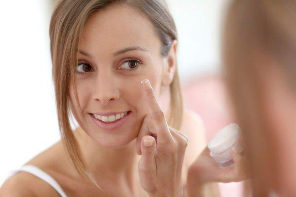 woman with beauty cream