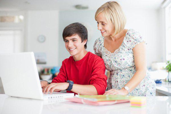 mother studying with son at computer