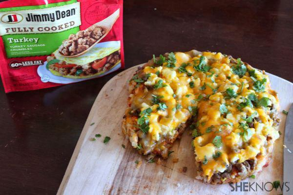 Breakfast sausage pizza with hashbrown crust