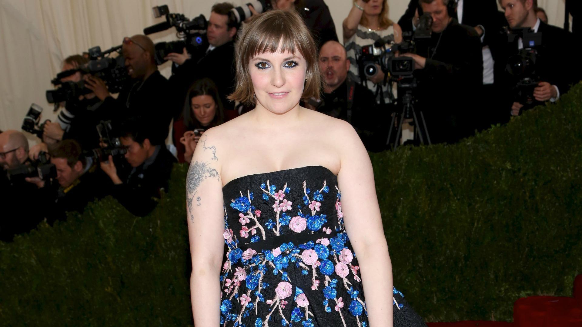 PHOTO: Lena Dunham's dog is a real pain in the butt