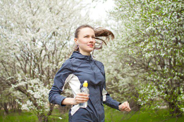 woman running in the park during spring